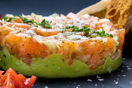 smoked: Extreme close up of appetizing smoked salmon tartar with avocado and onion.