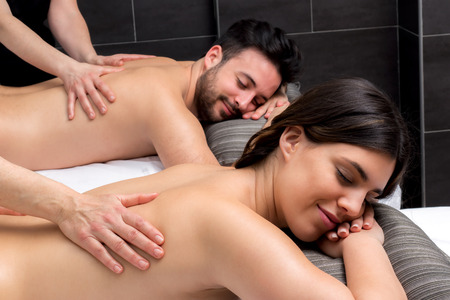 therapeutic: Close up of young couple enjoying therapeutic body massage together.