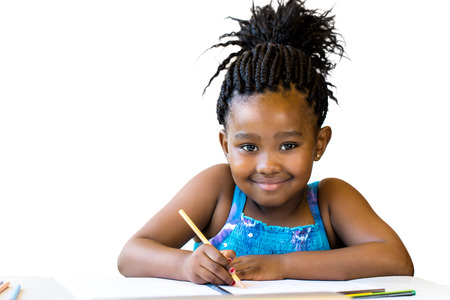 Close up portrait of little african girl holding color pencil at desk.Isolated on white background. Banque d'images