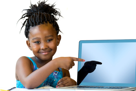 schoolkid: Close up portrait of cute african girl pointing at blank laptop screen.Isolated on white background. Stock Photo