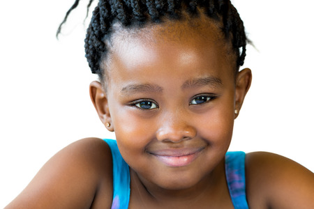 face shot: Close up face shot of cute smiling african girl with braided hair isolated against white background.