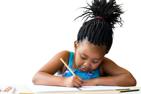 Close up portrait of cute african child with braids drawing with cool pencil.Isolated on white background. Stock Photo