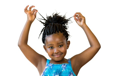 braided hair: Close up portrait little african girl playing with braided hair.Isolated against white background. Stock Photo