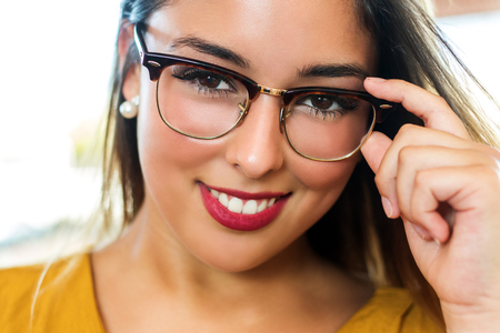 eye wear: Close up stylish portrait of attractive  young woman wearing eye wear. Girl with smooth skin and seductive smile.