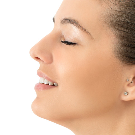 fullness: Macro close up side view beauty portrait of young woman smiling.Girl with eyes closed isolated against white background. Stock Photo