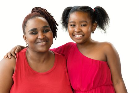 Close up portrait of smiling african mother and little daughter. Women dressed in red looking at camera. Isolated on white background.
