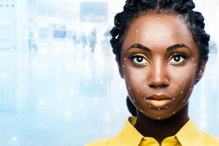 Close up portrait of attractive african woman with facial recognition technology. Grid with reference areas marked on face. Young girl against out of focus airport background. Archivio Fotografico