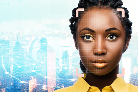 Close up portrait of facial recognition grid on african woman against city background. Zdjęcie Seryjne