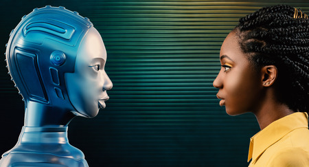 Side view portrait of attractive young black woman looking at her robot avatar. Two females looking at each other against green background.