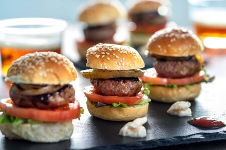 Close up of appetizing mini beef hamburgers on at catering event. Zdjęcie Seryjne