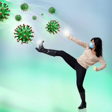 Conceptual full length portrait of woman fighting against infective virus cells.