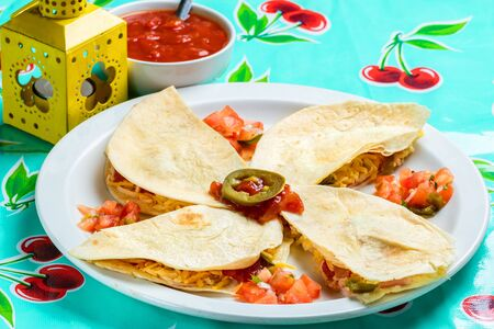 Macro close up of appetizing Mexican quesadillas with ham and cheese. Stok Fotoğraf