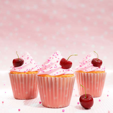 Close up 3d illustration of three cupcakes with pink swirled icing sugar  and cherrie dressing. Stok Fotoğraf - 156284154