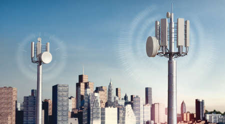 3D illustration of 5g telecom antennae with conceptual frequency waves. City skyscrapers in background. Stockfoto