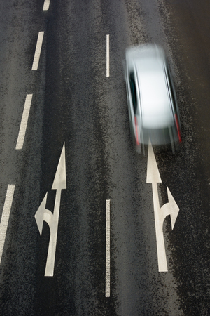 dividing lines: Asphalt road with dividing lines and car Stock Photo