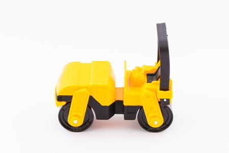 steamroller: Isolated model of yellow steamroller on white background. Construction machine as a toy. Rolling using a machine.