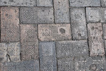 Close-up of dirty, patterned brick street paver detail on a Savannah, Georgia, street