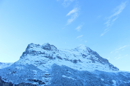 eiger: Eiger and the moon Stock Photo