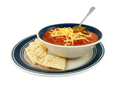Bowl Of Spicy Red Chili With Cheese And Crackers  Stock Photo