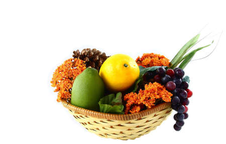 Fall Basket With Fruits, Flowers, And Pinecones  Stock Photo