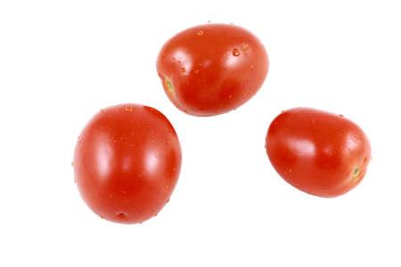 Three Plum Tomatoes Isolated On White Stock Photo
