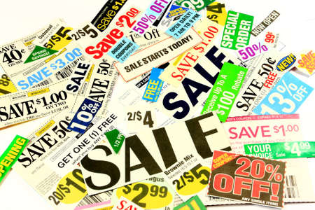 Saving Money With Manufacturer's Coupons And Special Store Deals Stock Photo