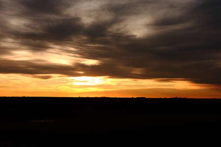 Orange Sunset With Dark Clouds