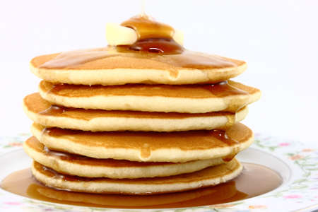 Stack Of Fluffy Pancakes With Butter And Syrup Stock Photo