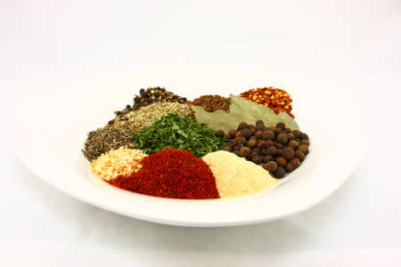 White Plate Filled With Dried Herbs And Spices
