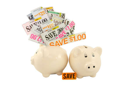 Grocery Coupons In A Piggy Bank  Stock Photo