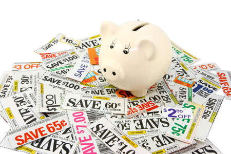 discounted: Piggy Bank With Many Grocery Coupons  Stock Photo