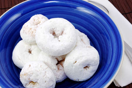 Blue Bowl With White Mini Powdered Sugar Doughnuts  Stock Photo