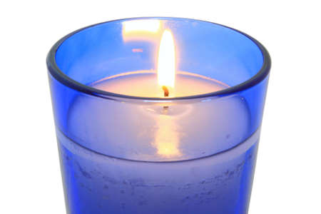 Lit Candle In Blue Glass Close Up