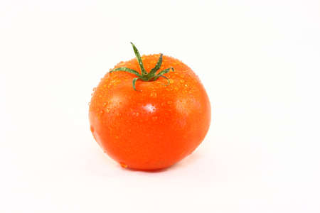 Wet Ripe Tomato Isolated On White