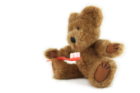 Teddy Bear With Toothbrush Stock Photo
