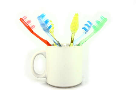 Colorful Toothbrushes In A White Mug Stock Photo - 12725270