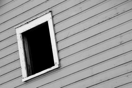 A Dark Window In A Gray Wall Stock Photo