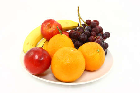 Assorted Fresh Fruits On A White Plate Stock Photo