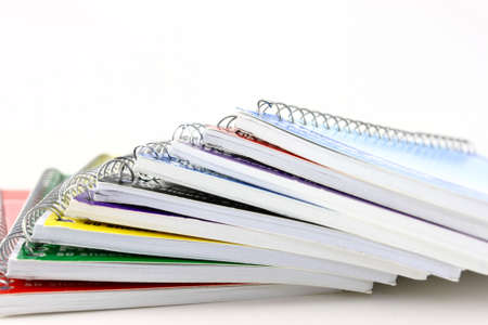 Pile Of Spiral Notebooks End View On White Stock Photo