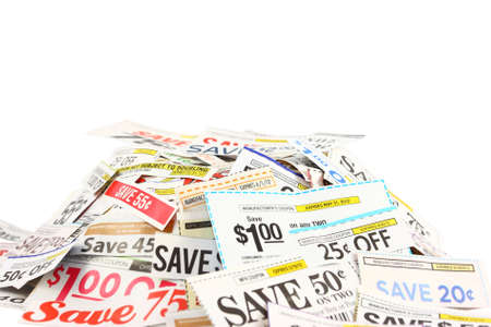 discounted: Money saving grocery coupons in a pile isolated on a white background. Stock Photo