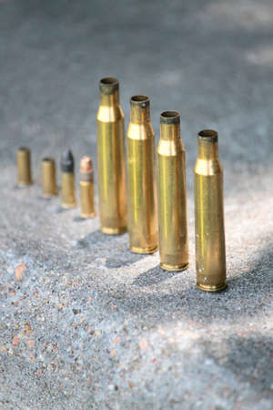 Spent Shells Lined Up On Concrete Stock Photo