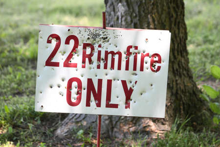 22 Rimfire Sign With Bullet Holes photo