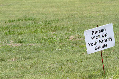 Empty Shells Sign At Outdoor Shooting Range