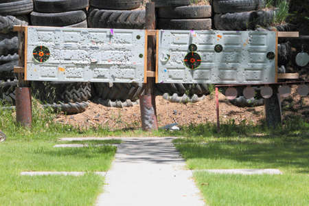 berm: Old Doors And Tires Used For Target Practice Stock Photo