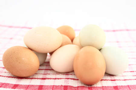 Assorted Colors Of Speckled Farm Fresh Eggs On Kitchen Fabric