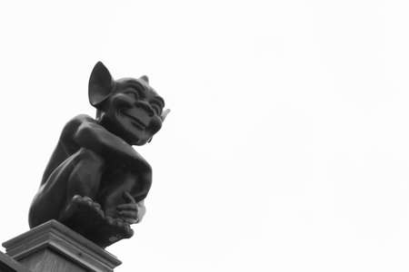 pointed arm: Cute Gargoyle With Pointed Ears