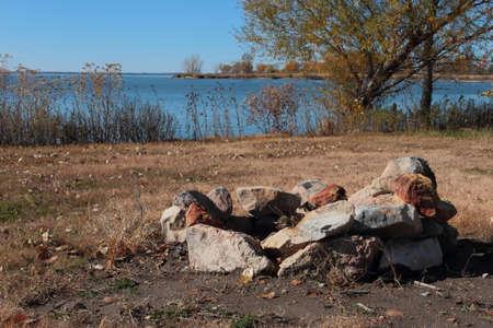 fire surround: Lakeside Campfire Area Stock Photo