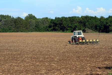 Tractor Planting The Field