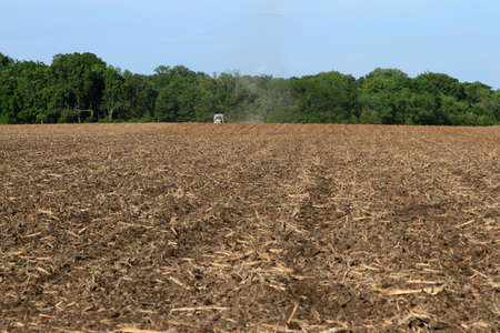 Field With Tractor In The Distance