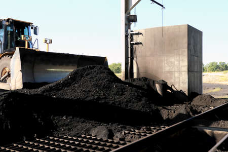 front end: Front End Loader Pushing Coal Into Pulverizer